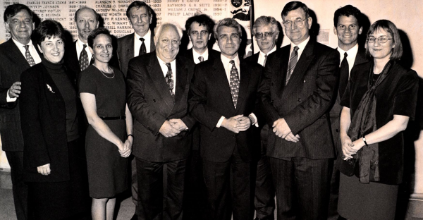 Black and white photograph of the attendees at the Jisc-JSTOR agreement signing at the United States Consulate in London, April 1998