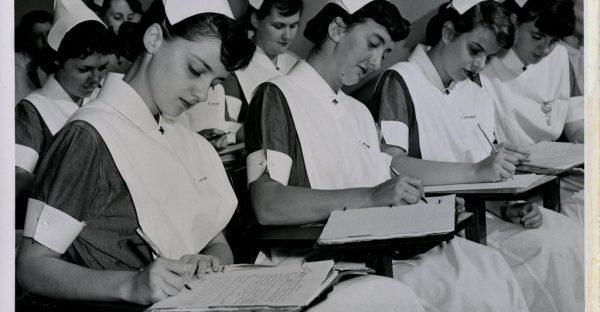 Classroom teaching to the class of 1954, photograph of six student nurses in the classroom. From the Philadelphia General Hospital School of Nursing