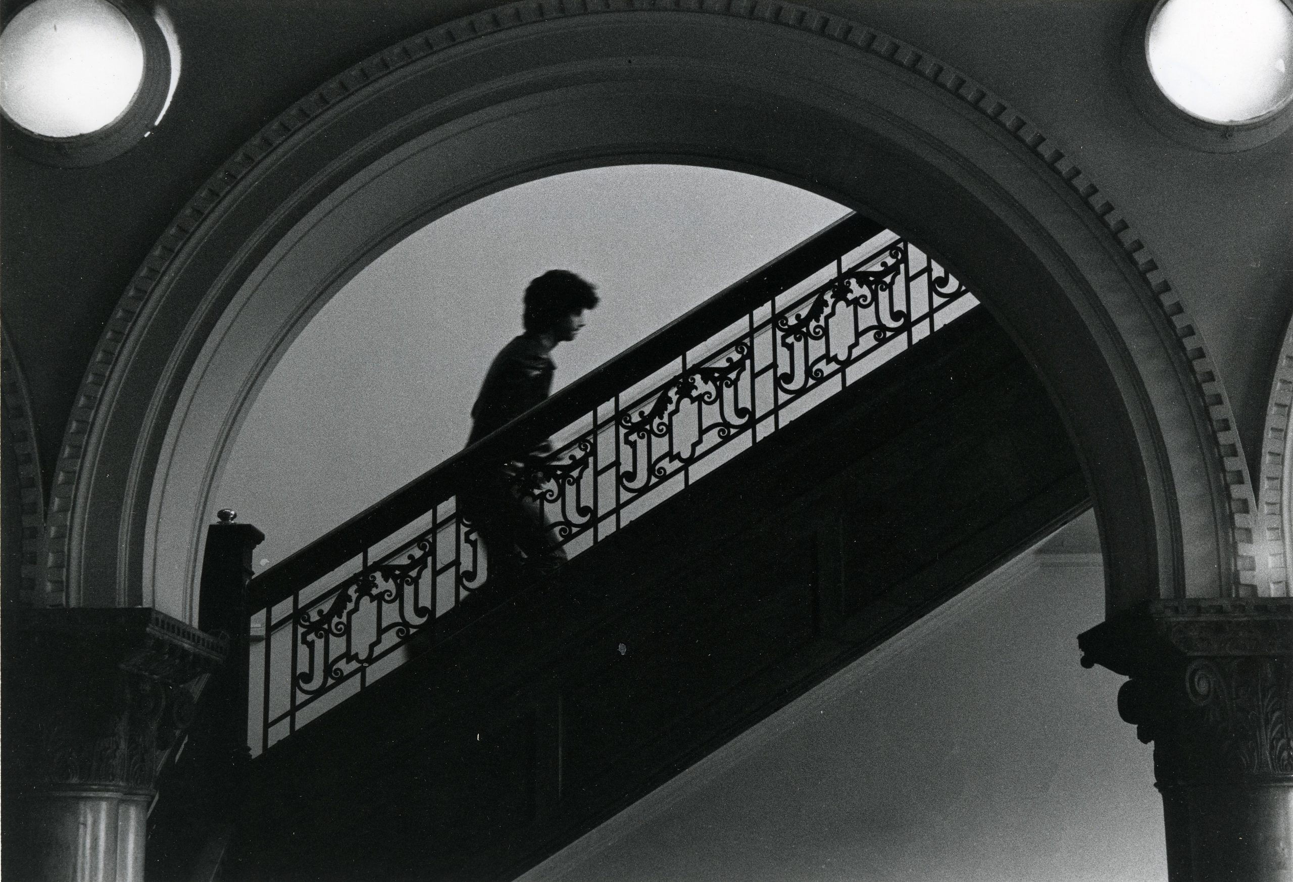 Photograph of student walking up staircase in the Pratt Institute Library