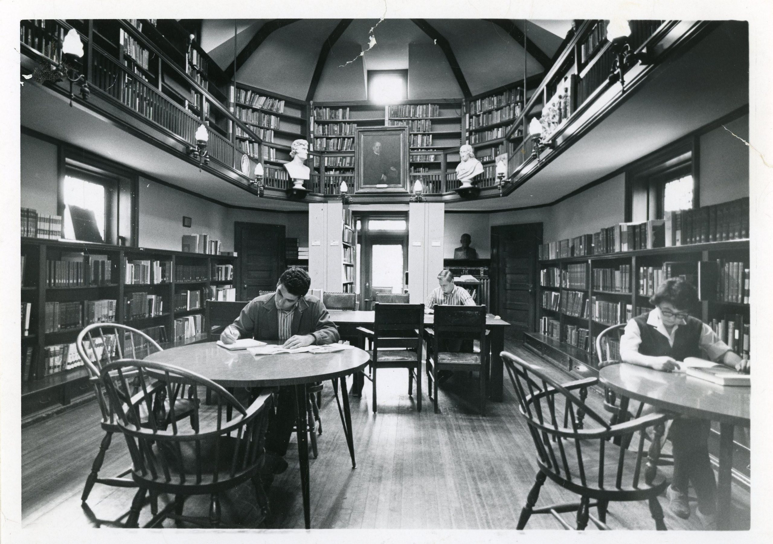 Black-and-white photograph of students and a woman reading in the Joseph Krauskopf Memorial Library