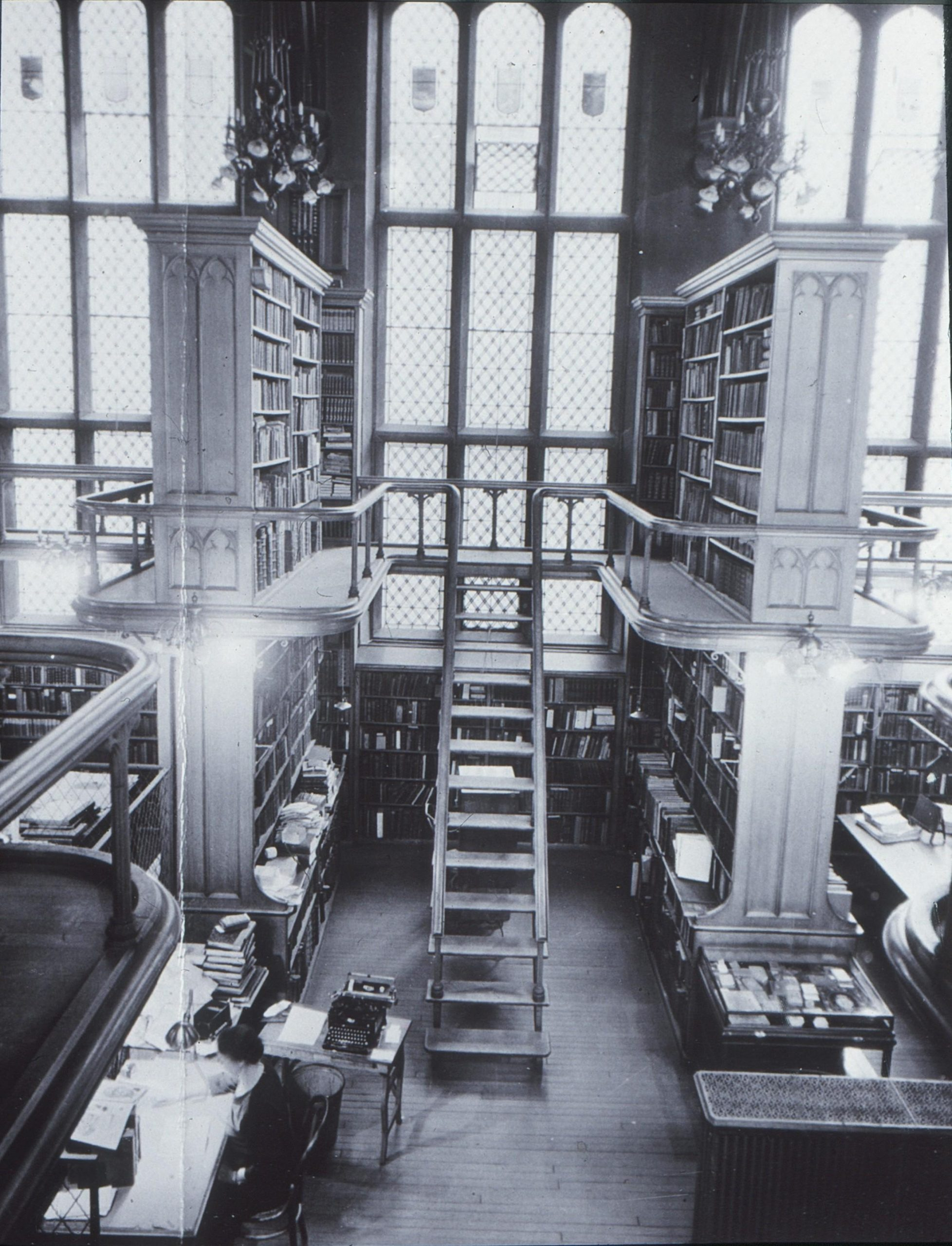 Photograph of the interior view of Watkinson Library Reading Room and book stacks