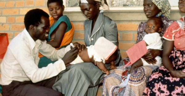 Photo of mothers holding children to be vaccinated